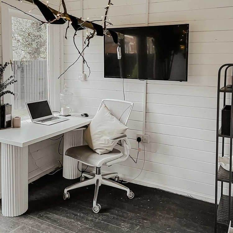BillyOh Fraya Pent Summerhouse interior painted white with desk and office chair and wall-mounted TV