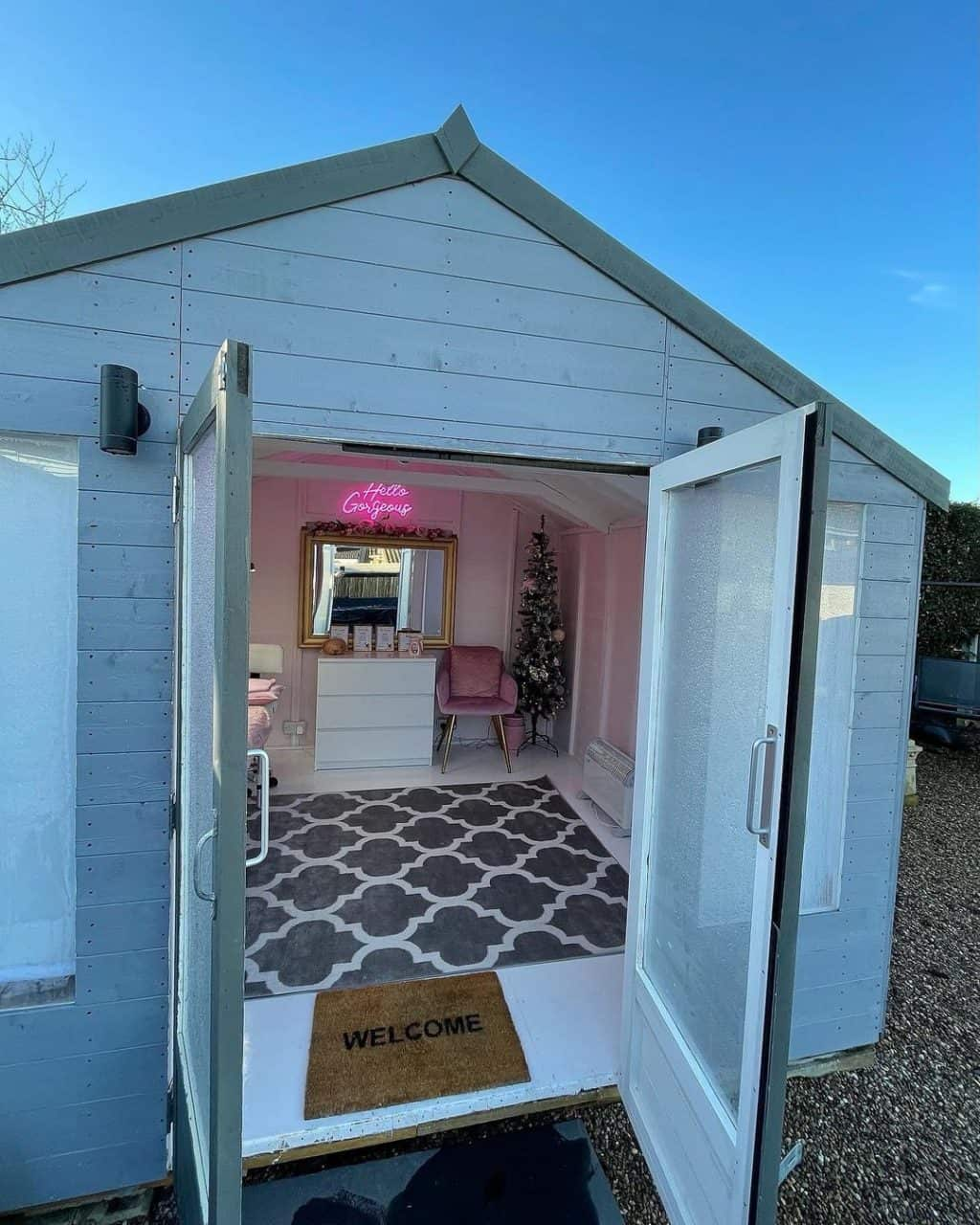 BillyOh Holly Tongue and Groove Apex Timber Summerhouse from outside with doors open decorated as a home salon inside