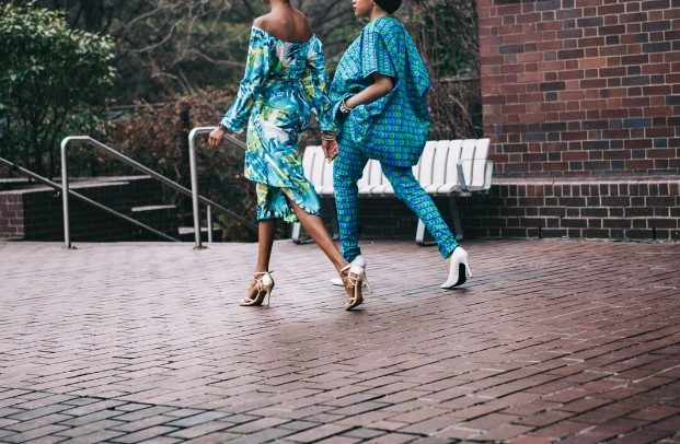 women in blue patterned clothing and heels walking