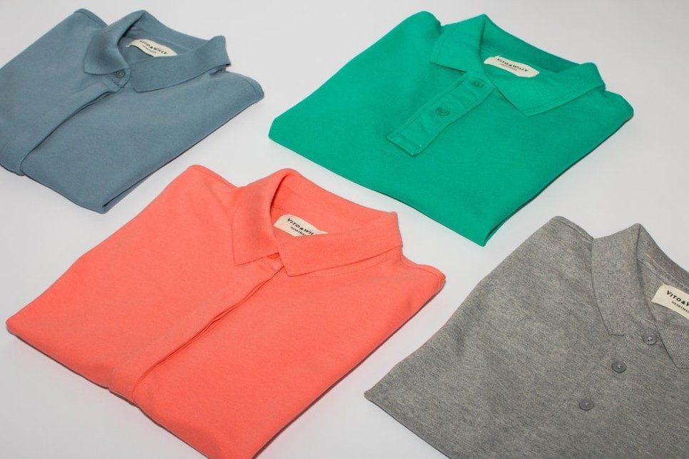 coloured shirts folded on a grey background