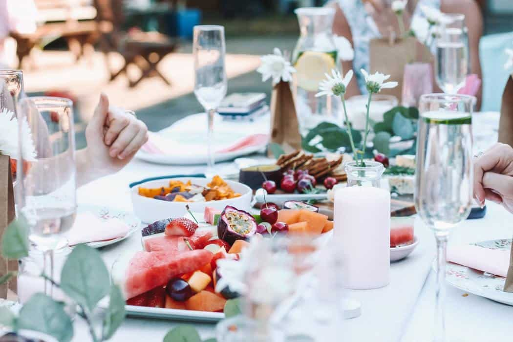 Dinner party table with food and drink