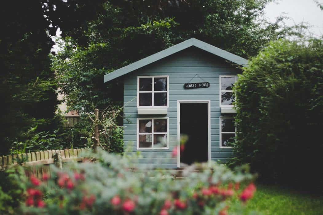 Child's blue wooden playhouse