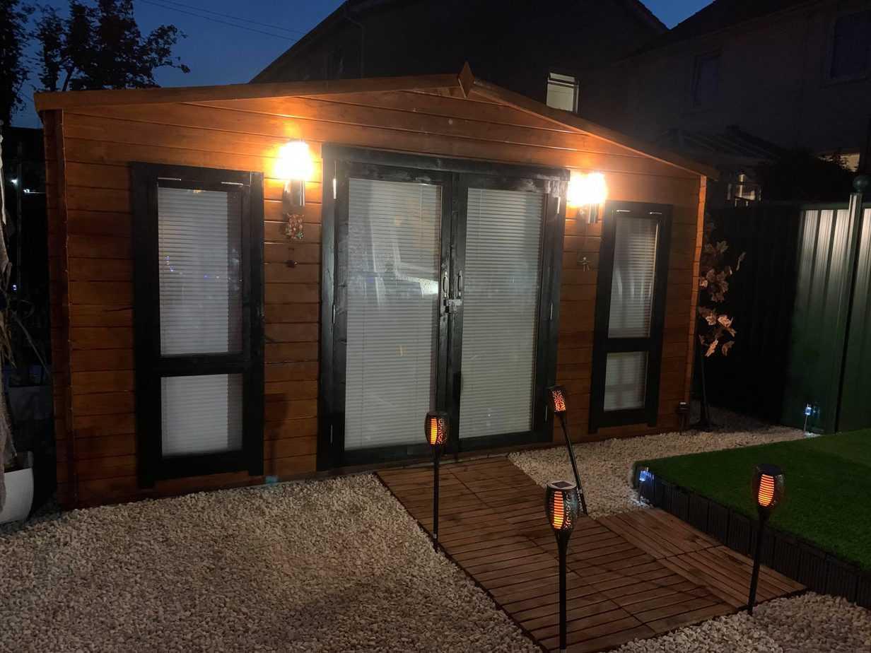 Elaine's BillyOh Sasha log cabin exterior lit up