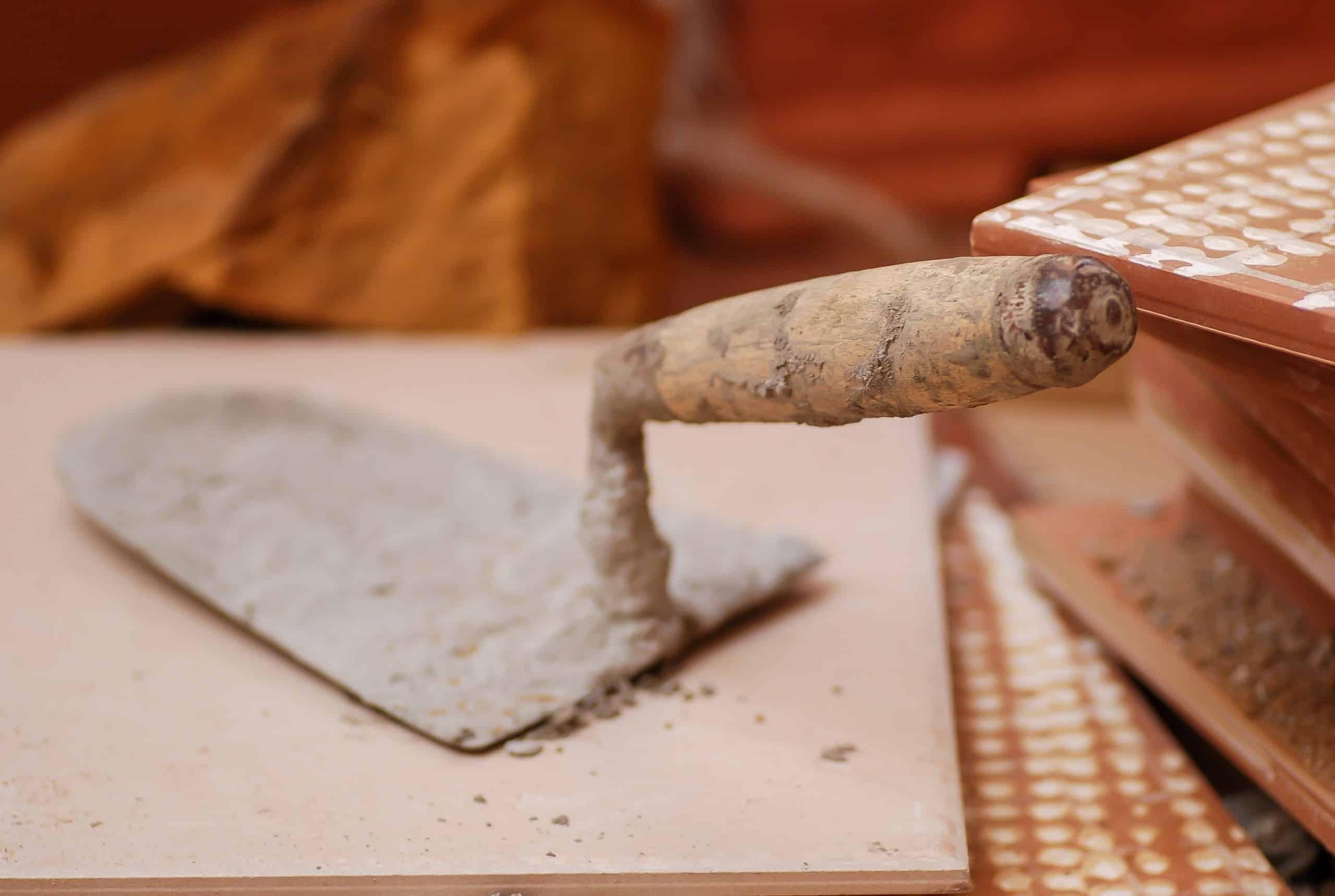 dirty hand trowel on tiles