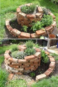 a well made out of bricks in a grassy back garden full of soil and planted with plants