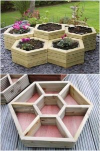 a modern tall wooden hexagonal shaped planter with lots of space for plants and herbs