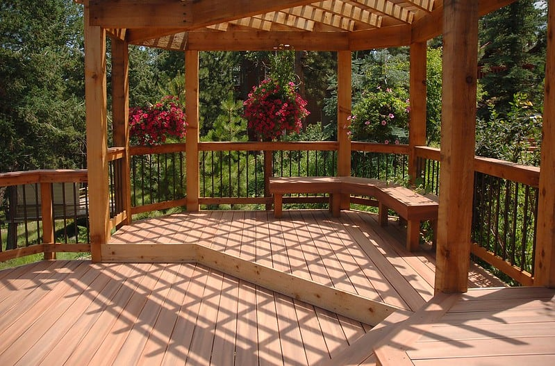 A sunny bench area on a wooden deck