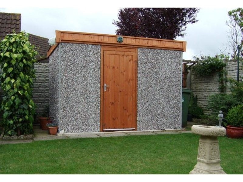 A mini concrete shed with wooden accent