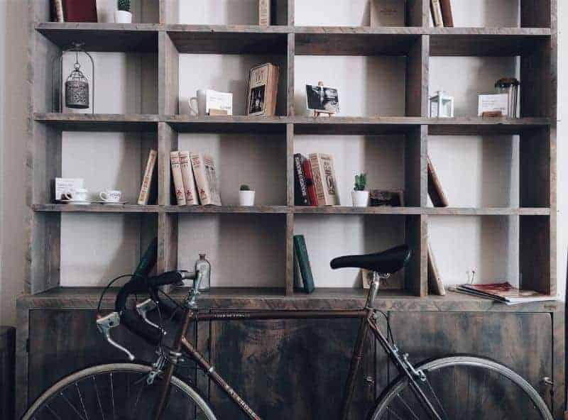 bike next to a dark brown bookshelf