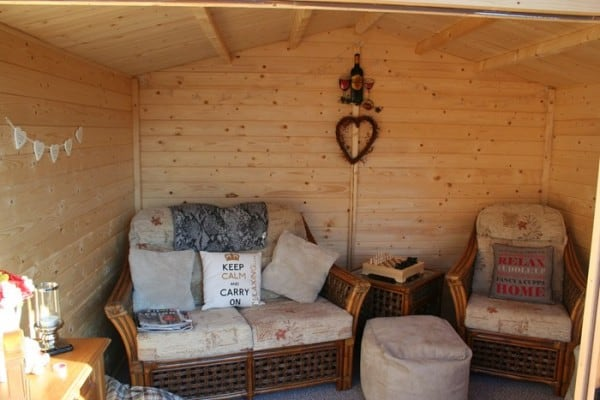 shed interior with chairs and keep calm and carry on cushion