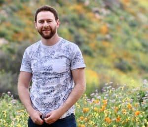 Jack Wallington stood in a field of flowers