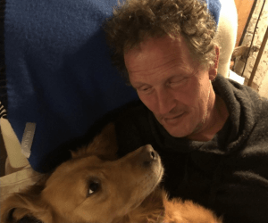 Monty Don on the sofa with his dog