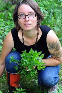 Gayla Trail of You Grow Girl kneeling among plants