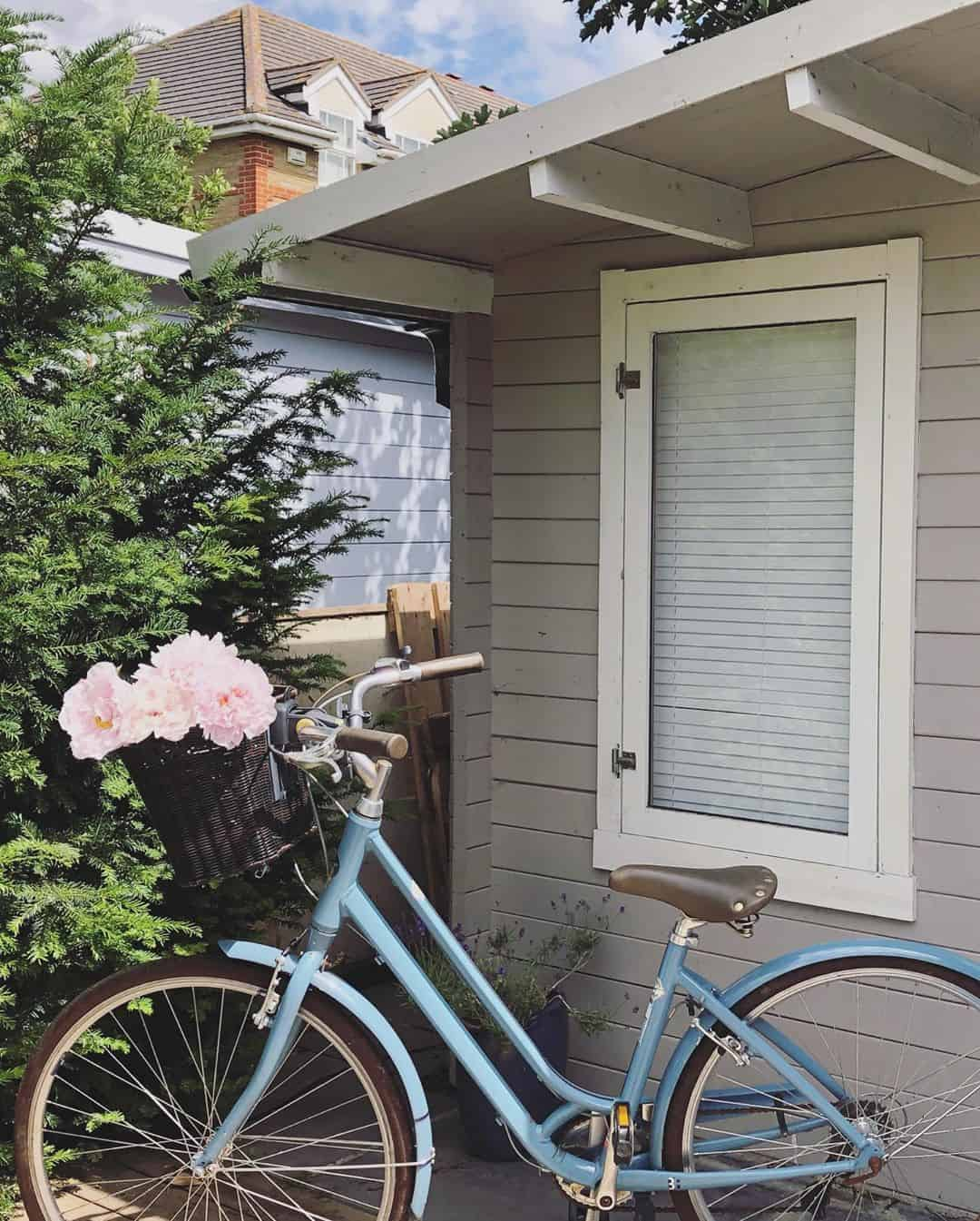 @athomewithjen__ BillyOh Winchester Log Cabin exterior with bike
