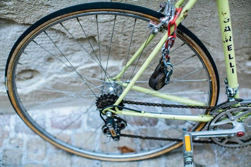 bike wheel and front part of frame against cobbled street
