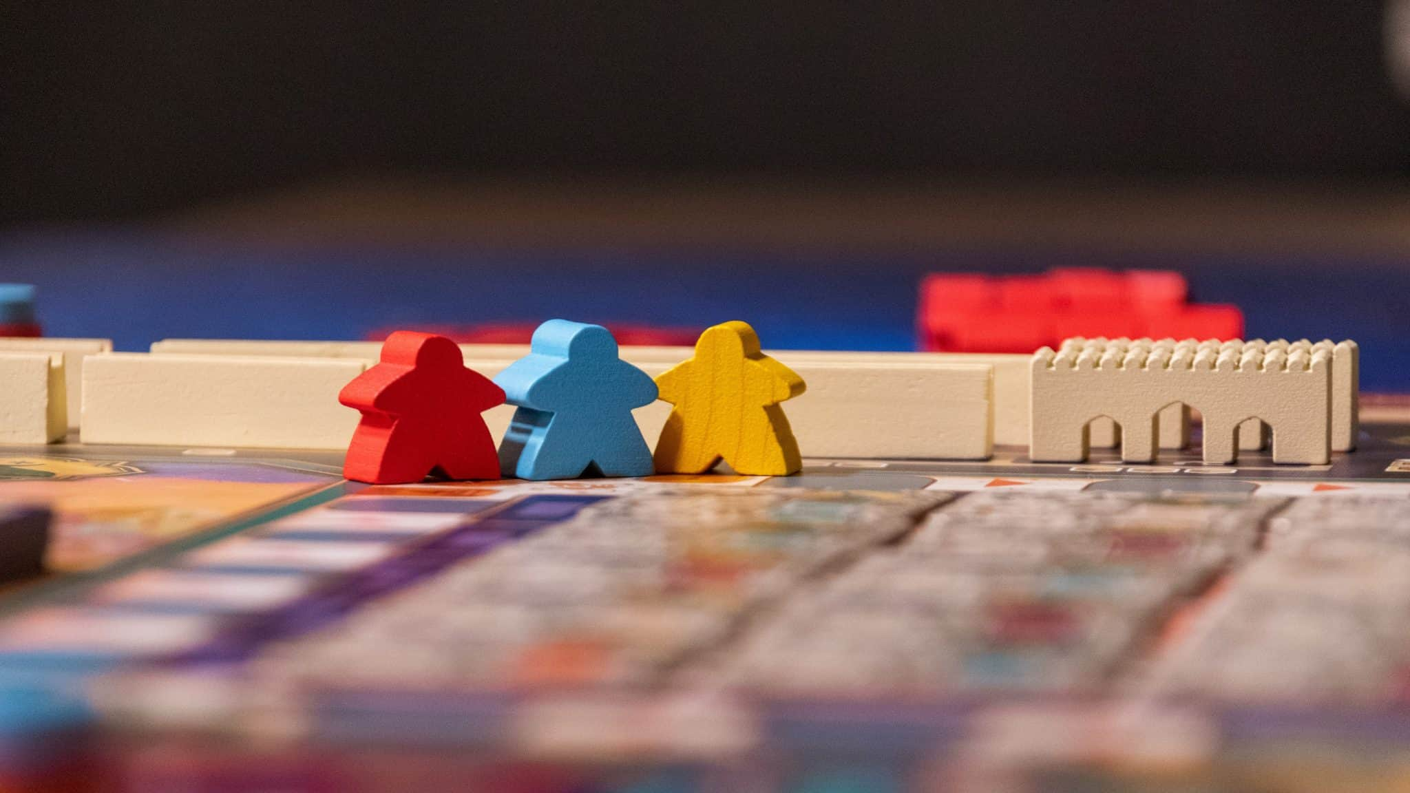 board game with multi-coloured wooden character pieces
