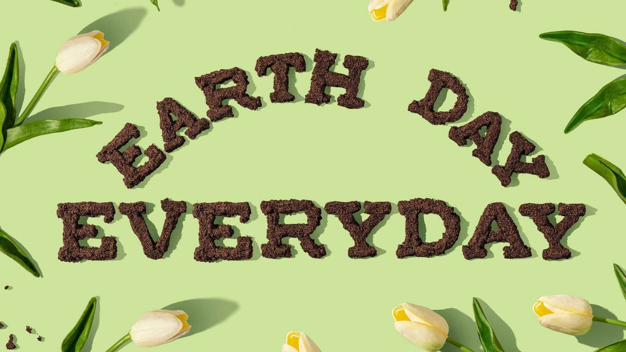 Earth Day Everyday cartoon on a green grass background with flowers
