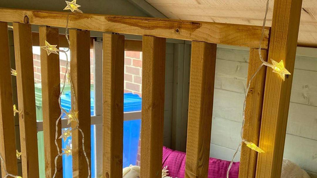 interior playhouse bunk with star shaped fairy lights
