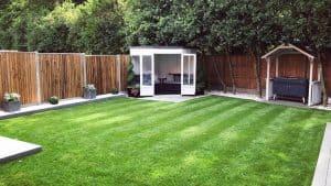 BillyOh Picton Corner Summerhouse painted white in a garden
