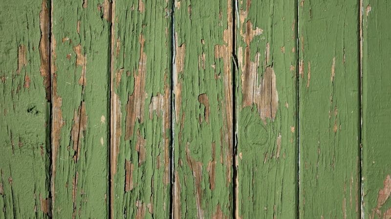 wood panels painted with cracking green paint