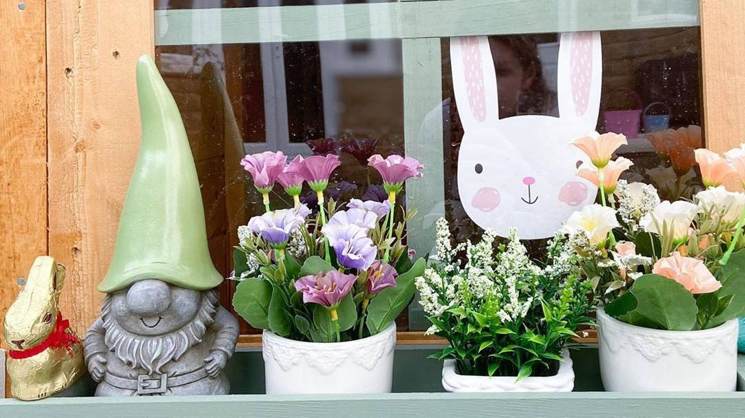 playhouse windows with planter box, gnome and bunny in the window