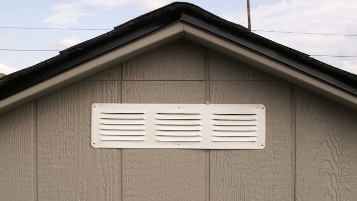 apex shed roof with white vents installed to shed eaves