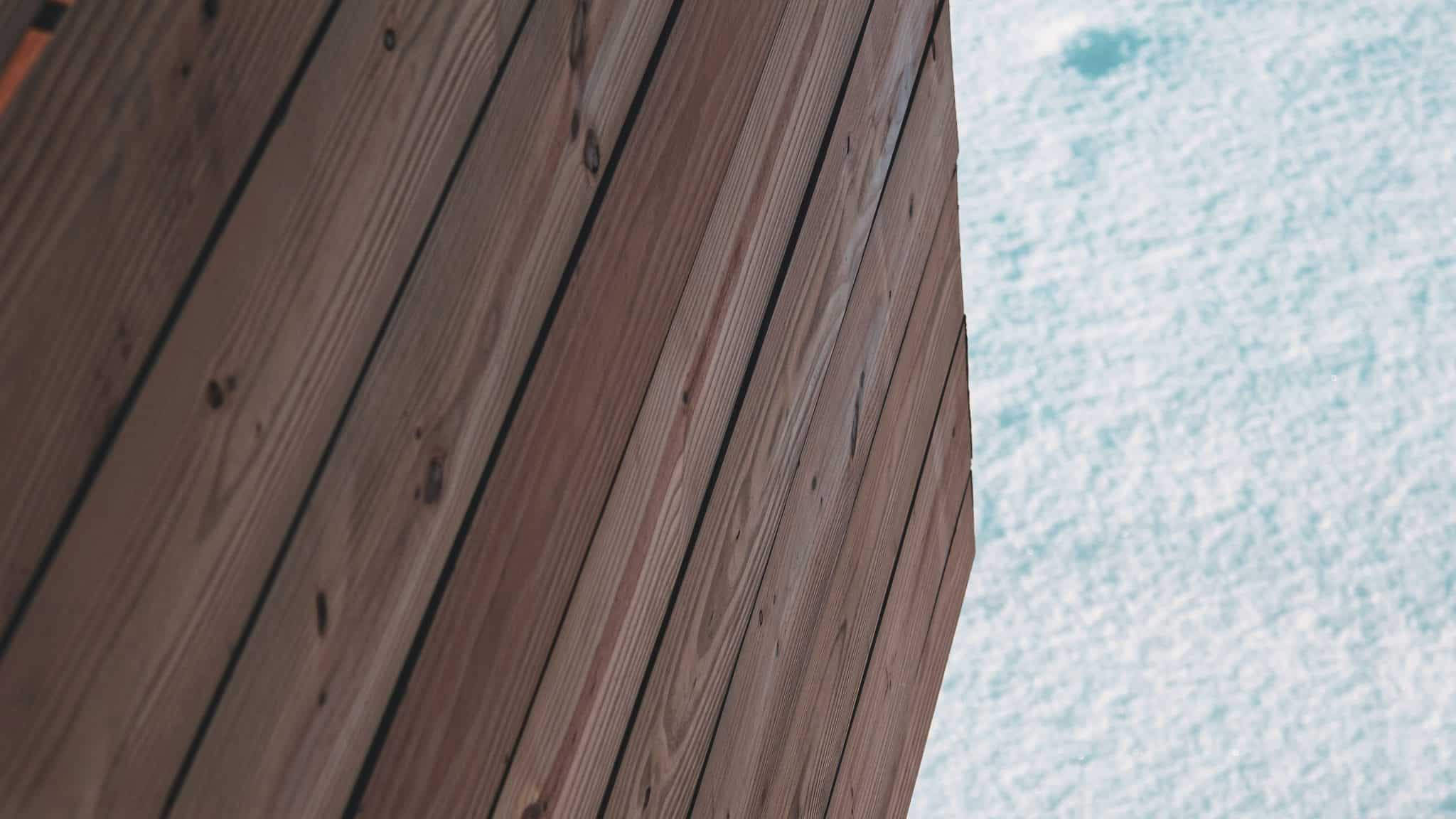 snow and wooden shed panels