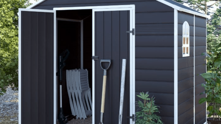 BillyOh Ashford Apex Plastic Shed in black uPVC with white trim and garden tools leant up against it