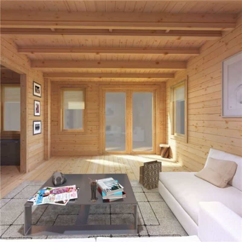 log cabin interior with couch and coffee table