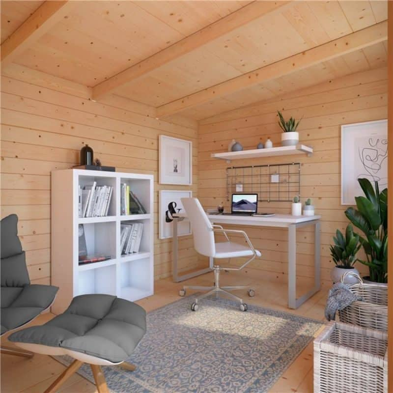 log cabin interior with desk and chair