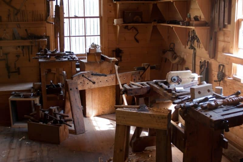 workshop interior with tools and stools in a wooden shed